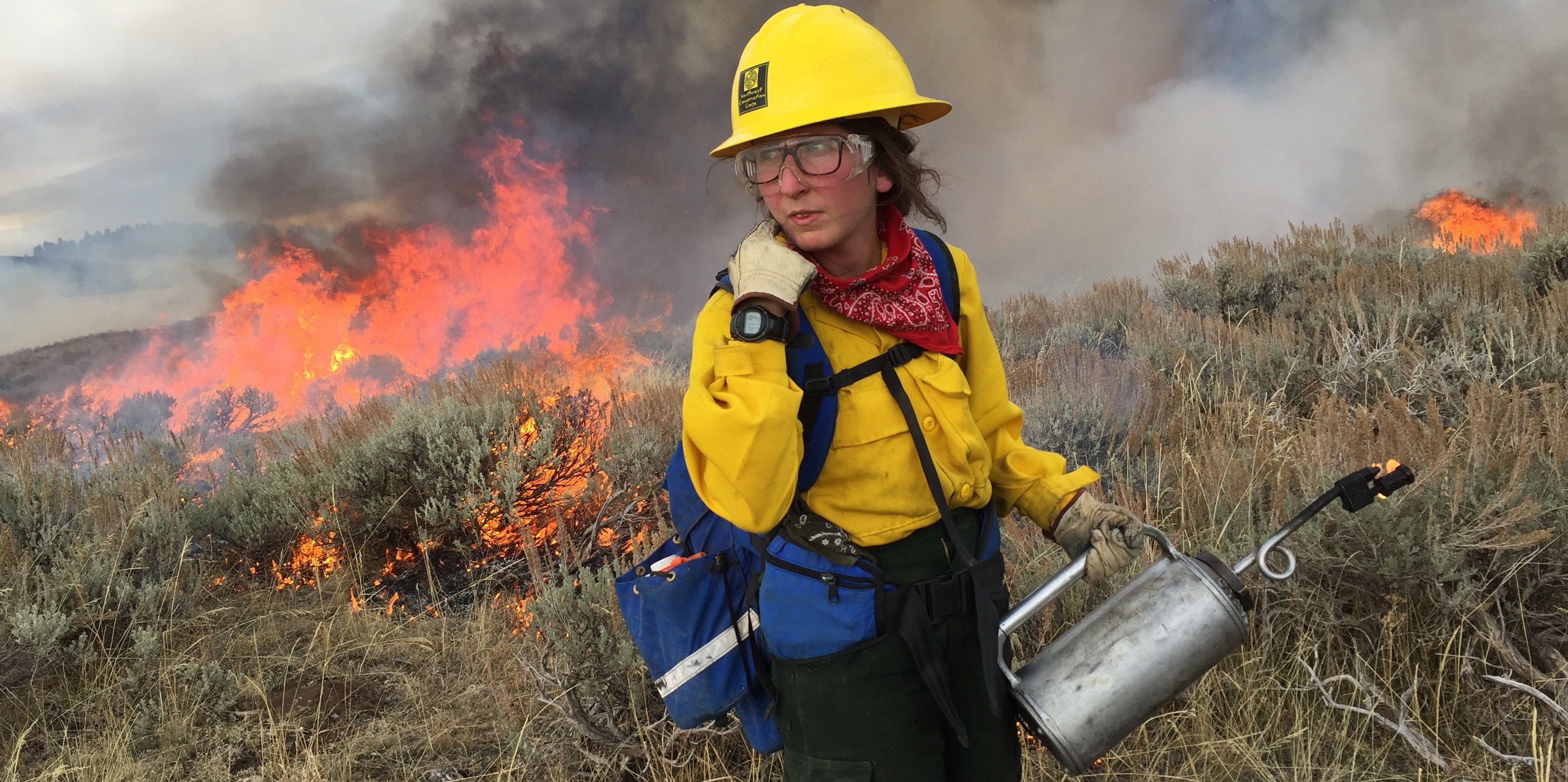 Women in Fire Corps Member with Driptorch