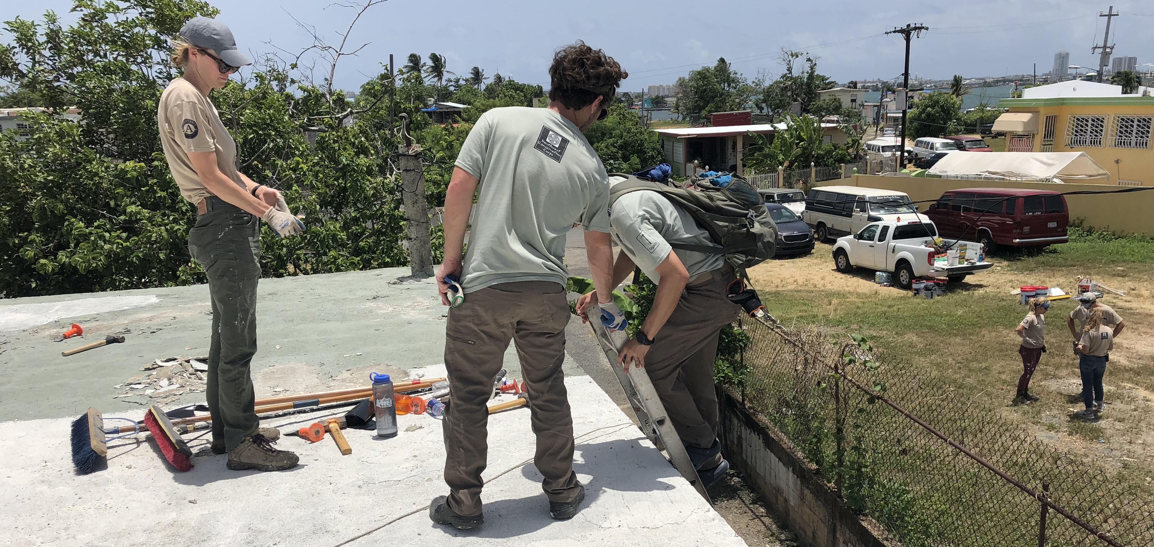 Crew members working on a roof in Puerto Rico